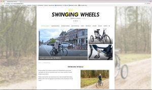 Foto van hoe de home pagina van Swinging Wheels eruit ziet.